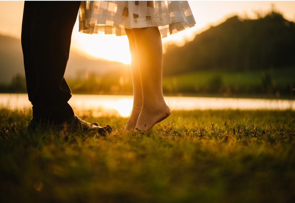 Healthy Marriage: Wife on tip toes to give husband a kiss