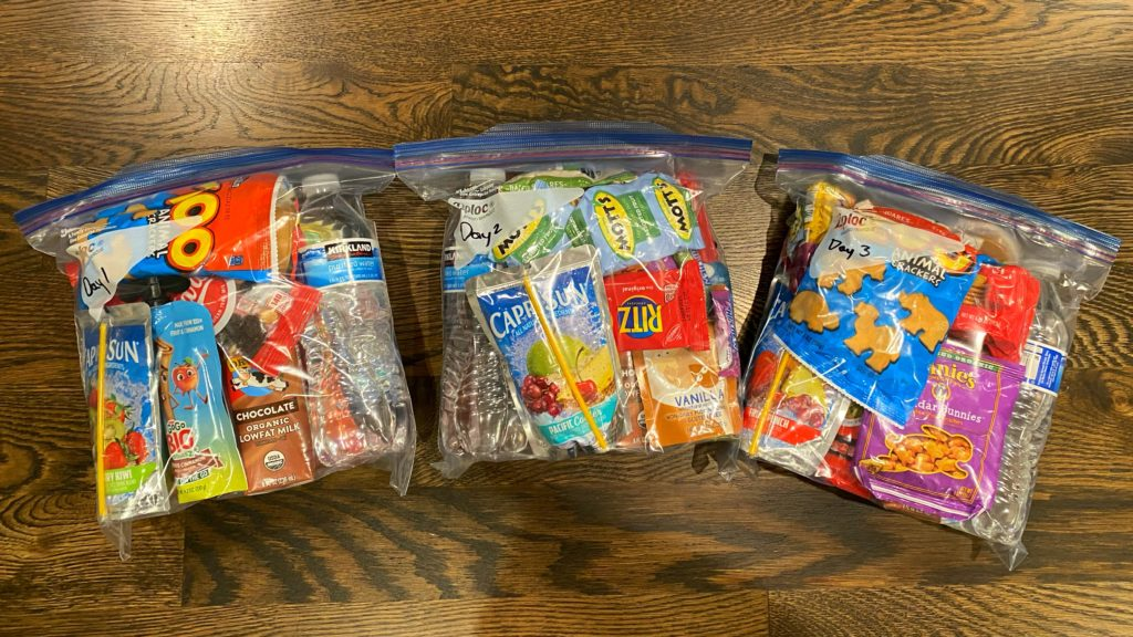 Bug out bag food packed in gallon sized freezer ZipLock bags.